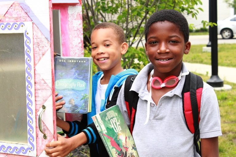 Boys choosing books from a local Cleveland Kids' Book Bank Little Free Library